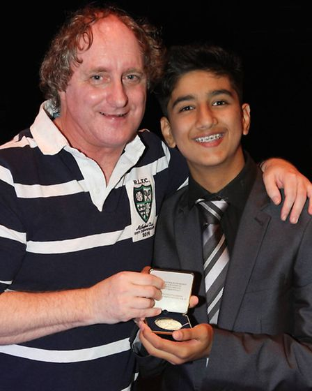 Zaeem Arshad from Rokeby School receives his award from the Recorder's news editor Russ Lawrence