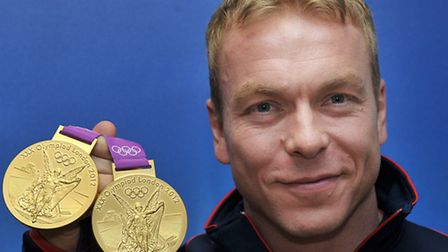 Sir Chris Hoy with his two gold medals from London 2012 (pic: PA/Tim Ireland)