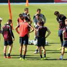England' manager Roy Hodgson (left) speaks with his players during a training session in Rio de Jane
