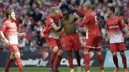 Orient's Moses Odubajo is mobbed after scoring at Wembley (pic: Simon O'Connor)