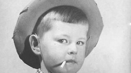 A shot of Alan Stevens aged four taken by his father for a poster for Barratts sweet cigarettes