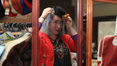 a fair-goer trying on a vintage head piece. Picture: Isabel Infantes