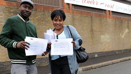 Trustees Isaac Mulondo, 24, and Joy Namata, 48, hold a petition outside the disused warehouse which