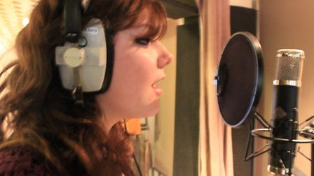 Sarah Bonnell pupil Amber recording the charity song