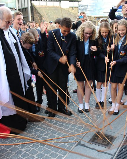 Pupils beat the plaques that mark the tower's borders with willow wands. Picture: Tower of London.