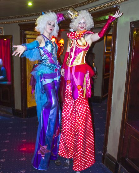 The night had a circus theme, with stilt walkers and magicians performing throughout the evening.