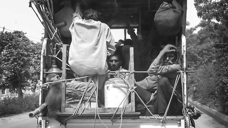 Men in the back of a truck, Lahore . Picture: William Titley.