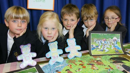 Year 1 pupils from at St Edwards school with their Seurat-inspired artwork