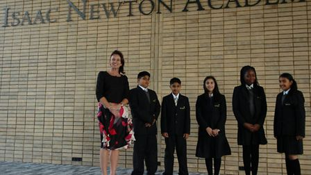 Principal Rachel Macfarlane and pupils outside Isaac Newton Academy, Ilford, which opened in Septemb