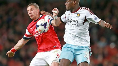 Guy Demel (right) battles Arsenal's Lukas Podolski for the ball (Picture David Davies PA Wire)