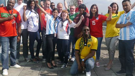 Staff at East Thames in their football shirts