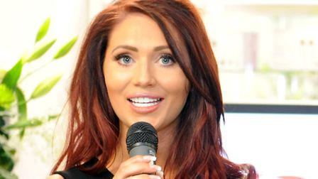 Amy Childs speaks at the opening of Urban Oasis commercial salon at Redbridge College.