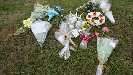 Flowers and messages at the scene of the crash