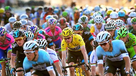 Team Sky's Chris Froome, of Great Britain, in the centre of the peloton as it makes its way along th