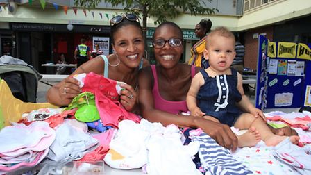 Shara Bennett, centre, with her mother Tracy and daughter Amber sells baby clothing at the Pier Para