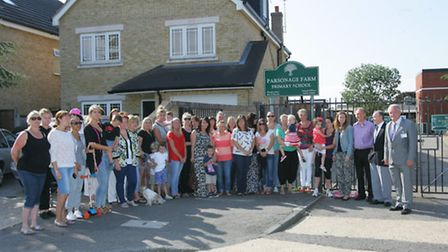 Parents and councillors at the gates of Parsonage Farm school