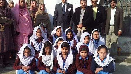 Sheikh Hussain with some of the children he works with. Picture: Children First
