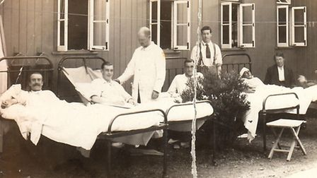 Atheling Miller in hospital after he was injured in a bomb blast (third bed on the left). [Picture: