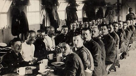 The soldiers having dinner in one of the huts. [Picture: Havering Museum]