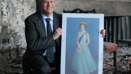 Romford MP Andrew Rosindell recued this portrait of the Queen from the rubble in Libya