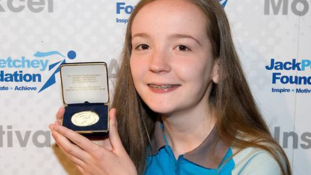 Fern Denyer, 14, with her medal. Picture: Stephen Pover