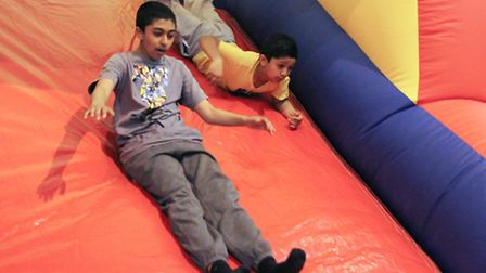 Children enjoy the bouncy castle at the fun day