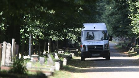 Police on the scene of a murder investigation at City of London Cemetery and Crematorium in Manor Pa