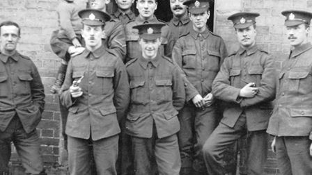 Sergeant Alfred Knight (with pipe) with his comrades