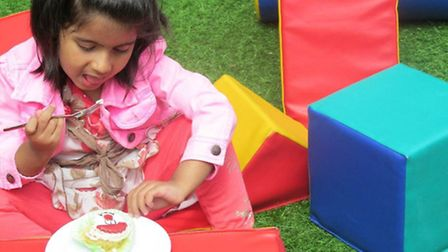 Arshya Verma, 4, enjoys a cake at the Busy Bees Ilford's Sweet 16 party