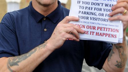 Mechanic Tony Hunter protest against proposed parking restrictions in Forest Gate