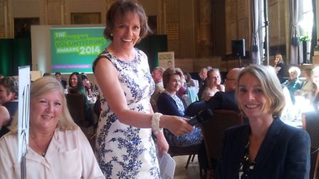 Clare Golden and Kate Green are pictured with TV presenter Esther Rantzen at the awards