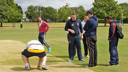 Arfan Akram (far right) looks on at the wicket inspection at Upminster on Saturday (Pic: Ray Lawrenc