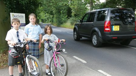 Connor Dowling, 10, Emily Kinder, 11, and Abigail Dowling, 7, outside Oakfields