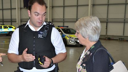 Acting Sgt Matt Sutton demonstrating the camera to chair of the Independent Advisory Group, Sheila K