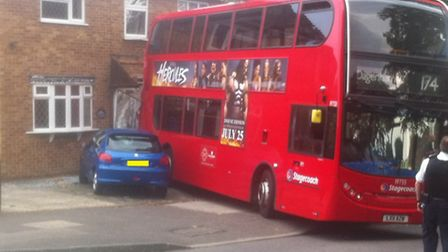 A bus has collided with a house in Dagnam Park Square, Harold Hill.