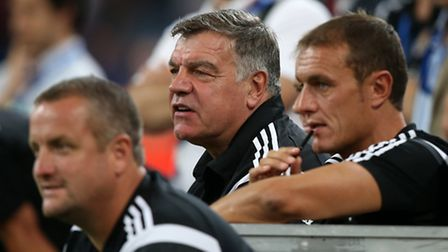 Hammers manager Sam Allardyce, (centre) watches from the bench during the penalty shoot out (Pic: Jo