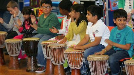 Pupils try their hand at African drumming
