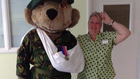 Janice Cassie from Romford Marks and Spencer with the Help For Heroes bear. Picture: Marks and Spenc