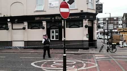A police officer outside the taped off pub