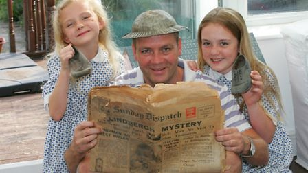 Amelia, Mark and Lauren McManus with the hat, shoes and old newspaper found under floorboards (Pictu