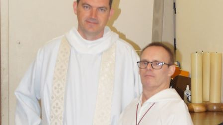 Sean Jacobs (right) with Father John Moloney at St Anthony's Church