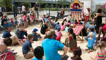 Young and old enjoyed a beach classic, the Punch and Judy show, at the man made beach at Royal Victo