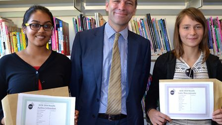 Lister headteacher Anthony Wilson (centre) with Aashna Jethmalani, who achieved 10A*s and two As, an