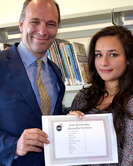Lister headteacher Anthony Wilson with Alexandra Scriitoru, who came to the UK from Romania aged 10,