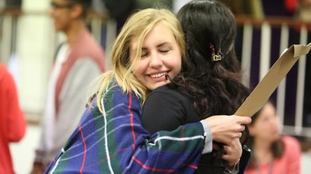 Student Jessica Jourja, 17, hugging Hina Khalid, 18, after picking up her A-level results at Beal Hi