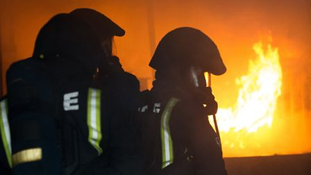 Firefighters tackle flames during a training exercise