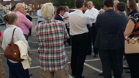 Cllr Russell Quirk addressing residents at the car park meeting on Monday.