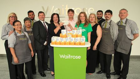 West Ham MP Lyn Brown donates a cheque to Macmillan following a cupcake fundraising event.