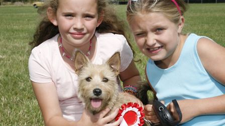 Brandy, winner of scruffiest dog with owners Chelsea and Grace. Picture: Sandra Rowse