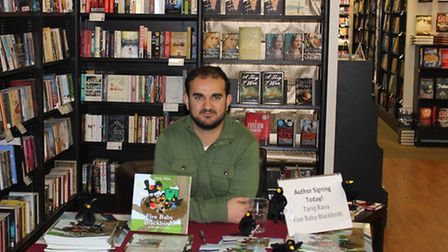 Clayhall children's author Tariq Rana at a signing of his book Five Baby Blackbirds